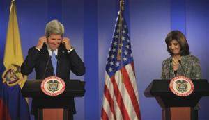 U.S. Secretary of State John Kerry smiles with Colombia's FM Maria Angela Holguin during a news conference at the presidential palace in Bogota
