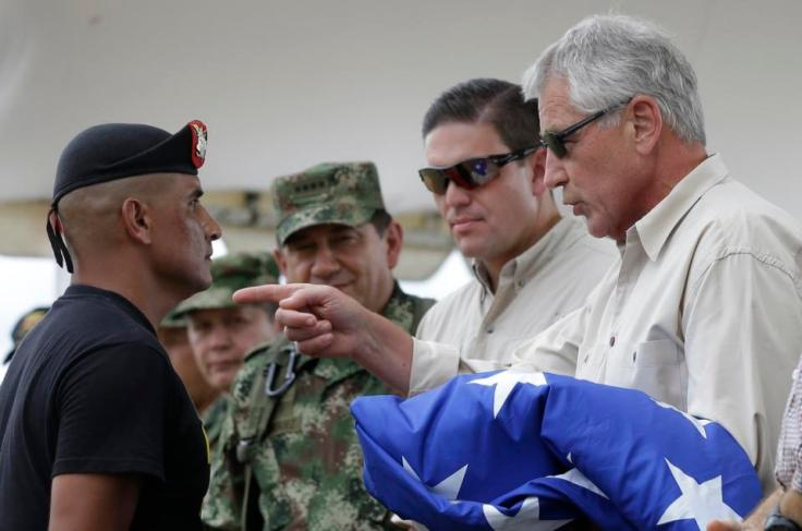 U.S. Defense Secretary Chuck Hagel, and Colombia's former Defense Minister Juan Carlos Pinzon, at the Tolemaida military base, in Melgar, Colombia