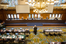 Hearing in session, July 2015, Peace Palace, The Hague. Clockwise from top left: Registrar and PCA Senior Legal Counsel Judith Levine; Judge Stanislaw Pawlak; Professor Alfred H. A. Soons; Judge Thomas A. Mensah (Presiding Arbitrator); Judge Jean-Pierre Cot; Judge Rüdiger Wolfrum; PCA Senior Legal Counsel Garth Schofield; former Secretary for Foreign Affairs of the Philippines, Mr. Albert F. Del Rosario; former Solicitor General Mr. Florin T. Hilbay, Counsel for the Philippines; Mr. Paul S. Reichler; Professor Philippe Sands; Professor Bernard H. Oxman; Professor Alan E. Boyle; Mr. Lawrence H. Martin.